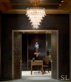 Skyline Penthouse, One of a Monumental Pair of Mazzega Glass Chandeliers, Italy c. 1960; Antique Japanese Sculpture In Likeness Of Fudo Myōō, Mid/late 16th century on Gilt Wall Shelf by Antoni Gaudí - Suzanne Lovell, Inc.