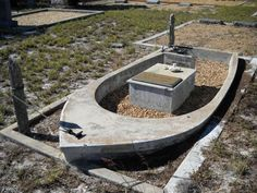 H. H. (Bill) Anger, (b. 1915 d. 1990) was a pioneer in the Englewood fishing industry, which accounts for his unusually shaped gravesite. His tombstone is placed inside the concrete boat, complete with steering pedestal and wheel, which is moored to two posts.