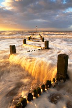 Hunstanton groynes, Norfolk, UK. The groynes in Hunstanton are odd in that they zig-zag across the beach instead of in a straight line