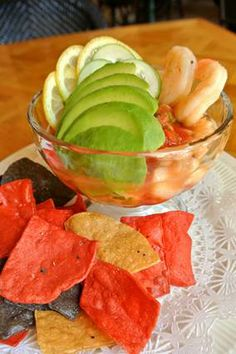 Cocktail Campechana: Tender scallops, shrimp and sole cooked in citrus, served with Mexican cocktail sauce, avocado  tortilla chips.