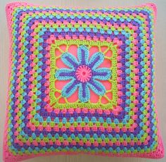 "I love the idea of the flower in the center of this ""Flower in a Granny Square Pillow""!"