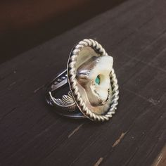 @sweetfarmjewelry Coyote tooth ring with a little peek-a-boo turquoise inside. #turquoise #coyote #tooth #itwasalreadydead #silver #sterlingsilver #handmade #metalsmith #instasmithy #riojeweler @riogrande