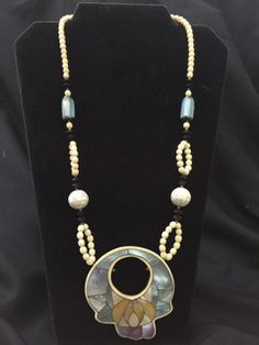 LEE SANDS ERA SHELL INLAY RESIN BEADED STATEMENT NECKLACE. MEASURES 24 INCHES IN LENGTH WITH LARGE PENDANT. GREAT CONDITION.