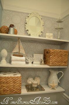 DIY floating shelves + baskets keep this small powder room organized @Beth Nativ Hunter