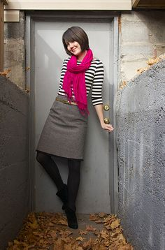 Gray skirt, black and white shirt, black tights, pink scarf