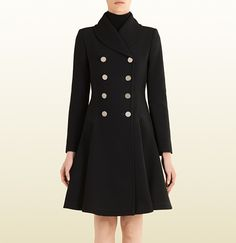 Gucci A/W14 - Made of stretch techno microfaille and black silk lining, this double breasted coat not only have has metal disc buttons that make this coat special, it also has a flared silhouette that adds shape to your figure. Price - $2800