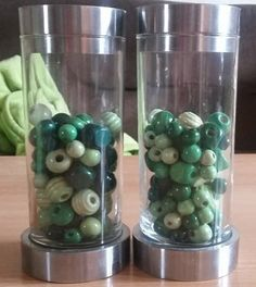 Candlesticks decorated with green wooden beads.