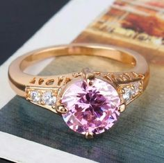 18k gold filled Pink Topaz statement ring size 9 18k gold filled Pink Topaz attractive statement engagement wedding ring size 9  Gem Type: Pink Topaz Gem Size: 8mm Gem Cut: Round Brilliant Gem Color: pink Metal Type: 18k gold filled Ring size: 9  Please do not compare gold filled jewelry to plated jewelry (usually only 3 mil layer) as there is no comparison, gold filled is much more valuable and tarnish resistant than plated. It does not flake off, tarnish or discolor.    Come with a pretty…