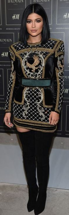 Who made  Kylie Jenner's blue belt, gold print long sleeve dress, and black thigh high boots?