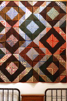 Log Cabin quilt. Like the interplay of strong secondary pattern of big boxes with the alternating alternating light and dark rings within the blocks.  3754KQM