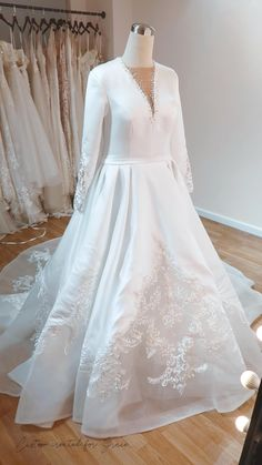 Inspired by a Pronovias wedding dress, this stunner has a sleek and glamorous silk cutout adorned with swirly dealing lace, fitted long sleeves, and a dramatic train perfect for a winter ceremony... Pronovias Wedding Dress, Wedding Gowns, Custom Wedding Dress, Bridal Musings, Bridal Style, Ball Gowns, Evening Dresses, Glamour, Train