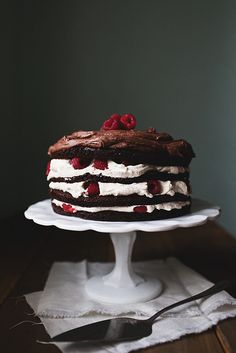 Layered chocolate cake with vanilla cream filling, raspberries and chocolate buttercream frosting