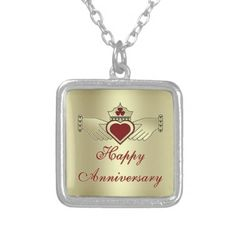 Gold Maroon Red Happy Anniversary Claddagh Custom Jewelry This Irish Claddagh design product features a royal crown, red heart, hands, shamrock and trinity knots. This symbolizes lasting love, friendship, loyalty and fidelity. Horizontal image, yellow gold color horizontally oriented. yellow gold color background. Great lucky Irish gift for St. Patricks Day holiday or someone of irish descent. The claddagh symbolizes love, friendship and fidelity.