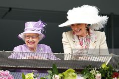 Queen Elizabeth II and Princess Michael of Kent watch the racing as they attend Derby Day of the Investec Derby Festival at Epsom Racecourse on June 7, 2014 in Epsom, England.