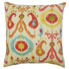 A festive vibe to your living room or bedroom with this charming toss pillow. This decor piece features an ikat pattern in shades of white, orange, blue and blue. It easily combines with other statement piece in your home which makes it a must-have piece. $55.00 #ikat #pillows #homedecor #tosspillow