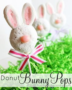 "Donut Bunny Pops TUTORIAL- powdered mini-donuts, marshmallows for ears (flatten marshmallow and cut shape with scissors or cut with bunny cookie-cutter) and painted with pink food coloring, small round pink candy, white chocolate or almond bark for ""glue"" to add pink nose to donut, lollipop stick & ribbon."