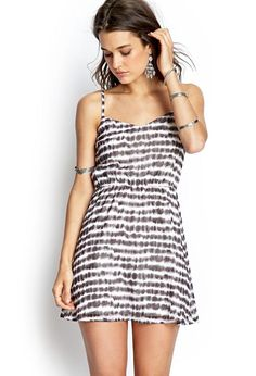 This cami dress features a striped tie-dye print and adjustable shoulder straps. Finished with a ...