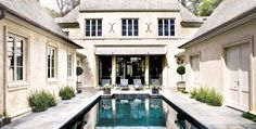 A pool is elegantly incorporated into the outdoor space of this D. Stanley Dixon house featured in Atlanta Homes Magazine.