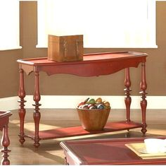 """Mill Valley Sofa Table $239  Mill Valley in the weathered red finish will add to any room as a single accent piece or as the complete  collection. The vase, ring, and bulb leg turnings and added physical distressing give each piece the  appearance of a treasured antique. Any collectable you add to the display cabinet will standout better against  the red background. Give your room added flair with Mill Valley tables.  Dimensions:  50"""" x 16"""" x 29"""""""