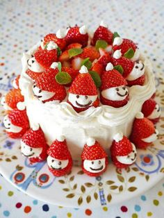 Strawberry Snowman Cake - Decorate a cake with white icing. cut strawberries horizontally, pipe cream onto base, use icing pen or melted chocolate in piping bag with nozzle draw smile & eyes, then position the hat on top & place finished snowman on cake (can add mint leaves).