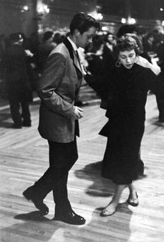 A Teddy Boy dances with his girl at The Royalty Mecca Dance Hall, Tottenham, London 1954.