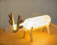Wonderful looking reindeer inspired lamp. Using conventional things around the hose like bottles and a dab of creativity can create a work of art.