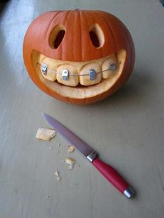 Pumpkin with braces, so cute, especially if your little one has them. #Halloween