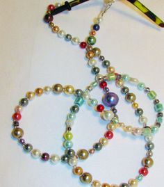Multicolored Glass Pearl Beaded Eyeglass Chain by nonie615 on Etsy, $21.00 I can fingertips to a key or id name tag as well.