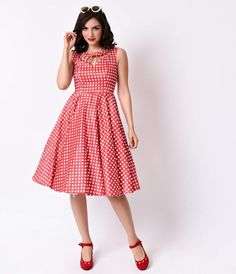 Made for marvelous movement, darlings. The Hacienda retro swing dress is a breathtaking Unique Vintage original complete in a stretch sateen that clutches curves with silky support. Patterned in a red and white check and featuring a boat neckline that res
