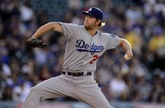 Jun 1, 2015; Denver, CO, USA; Los Angeles Dodgers starting pitcher Clayton Kershaw (22) delivers a pitch in the first inning against the Colorado Rockies at Coors Field. -  Ron Chenoy-USA TODAY Sports