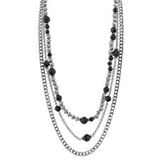 Be charmed with this lovely tripled-layered beaded necklace. Features a medley of silver-tone chains with various styled beads of black, silver, and flower that are arrange in a loving sequence giving its own unique design. The perfect style essential for any woman's closet.