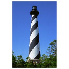 A landmark of the Outer Banks, the historic Cape Hatteras Lighthouse, in Buxton, North Carolina is shown in this photo. This print is created with archival inks on a matte surface photographic paper with a softened border and is signed by the artist.