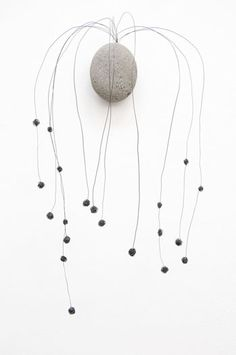 Mari Andrews. Stone with wires. Organic sculptures