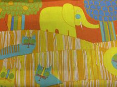 Vintage 1980 Waverly Schmacher Fabric. Childrens print called Safari featuring an elephant, lion, crocodiles, and cats that comes with an orange or a blue background. Lovely colors.  100% cotton  48 wide (doublefold)  Sold by the yard. If you buy more than 1 yard, I will adjust the shipping costs accordingly so you only pay for the actual shipping cost.