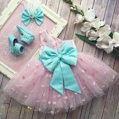 Spring has sprung at IBT! This happy pink and teal dress will make everyone smile. Four layers of tulle make this daisy embroidered asymmetrical dress a lovely Little Dresses, Little Girl Dresses, Girls Dresses, Flower Girl Dresses, Kids Frocks, Frocks For Girls, Little Girl Fashion, Kids Fashion, Tulle Skirt Dress