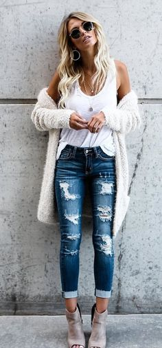 women's white tank top and distressed blue-washed jeans outfit