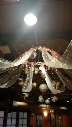 Homemade wedding canopy!  Hula-hoop, sheer table runners and fishing line!!