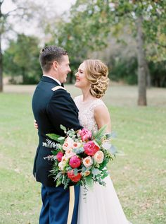A bride and groom embrace and smile at each other during outdoor portraits at wedding venue Kindred Oaks // Jen Dillender Photography