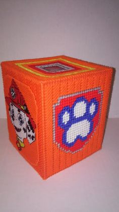 Marshall Tissue Box Cover, Puppy Power Box, Plastic Canvas Box, Paw Patrol Tissue Box, Get Well Gift, Dalmatian, Teacher Gift, School Supply ******************************************************************** This is an original design made by Maiden Long Islands in house plastic canvas creator! The orange plastic canvas boutique sized tissue box cover has paws on 2 sides of the box. The back of the box has the Marshalls shield and the front has adorable Marshalls face. We always love…
