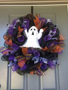 A personal favorite from my Etsy shop https://www.etsy.com/listing/479681739/halloween-wreath-ghost-deco-mesh-wreath