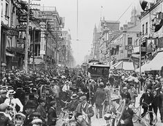 This chaotic street scene from early June, 1900, shows Yonge St., looking north from Adelaide. In the common, age-old phenomenon of Torontonians congregating on Yonge Street in celebration, these men and women and children are celebrating the fall of Pretoria in the South African war (1899-1902). Posted in support of #biketowork month Toronto