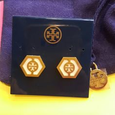 Tory Burch stud  earrings Beautiful Tory Burch earrings in gold and white. .size is larger than 2 other earrings being sold..worn twice. .Authentic! Tory Burch Other