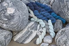 Hebridean 2 Ply on the patterned stones of a Lewis shingle beach.
