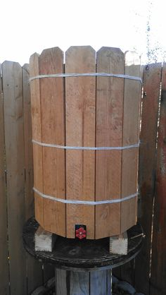 50 gallons rain water barrel covered in cedar planks Collect Rain water and use it at another time! Perfect for watering the lawn or garden.