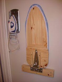 DIY Hideaway Ironing Board. Awesome wall mount ironing board DIY!