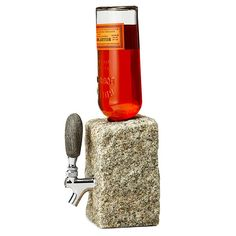 No Man Cave is complete without this rugged and stone-age drink dispenser. Whether your quantum of solace is equipped with a bar or mini-fridge, this drink disp