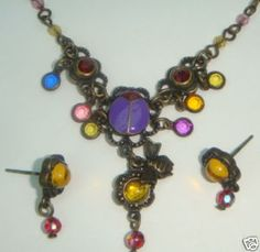 ANTIQUED BRASS FINISH - TEENEE TINY CRYSTAL ACCENTS - 2 MM (SMALL) BEADS ON THE CHAIN AND 4MM DROPS - MATCHING POST EARRINGS THAT MEASURE 3/4'S OF AN INCH LONG - YUMMY PURPLE AND RED ENAMELING ON THE LADYBUG - ONE TINY DANGLING BEE CHARM - THIS ONE MEASURES 20 INCHES LONG WITH ANOTHER 2 INCH EXTENDER CHAIN