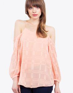 – Burnout long sleeve cold shoulder top – Tassel fringe ties – Lined  Size + Fit – Model is wearing size S – Measurements taken from size S – Length: 24″ – Waist: 34