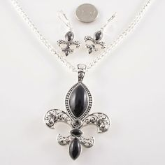 NEW! FLEUR DE LIS SILVER NECKLACE AND EARRING SET . INCLUDES 18 INCH CHAIN.