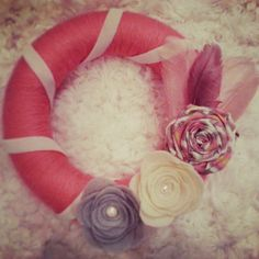 Shabby chic wreath. Pink yarn wrapped wreath with feather and flower embellishments. by SparrowNbirch, Etsy Shop